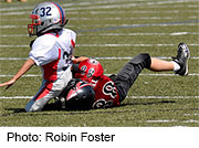 Boys who start playing tackle football before the age of 12 may face a higher risk for neurological deficits as adults