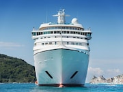 Hundreds of passengers and crew members of a Church of Scientology cruise ship remain under quarantine in its home port of Curacao while awaiting measles test results.