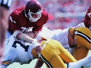 A number of former American-style football players report clinician-diagnosed chronic traumatic encephalopathy