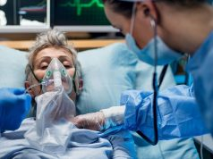 Infected patient in quarantine lying in bed in hospital